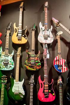 Steve Vai's Ibanez guitars hanging in Harmony Hut